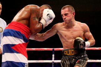 Quigg empató con Salinas y retuvo el título interino supergallo AMB.