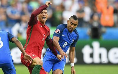 Payet y Cristiano Ronaldo durante la Euro