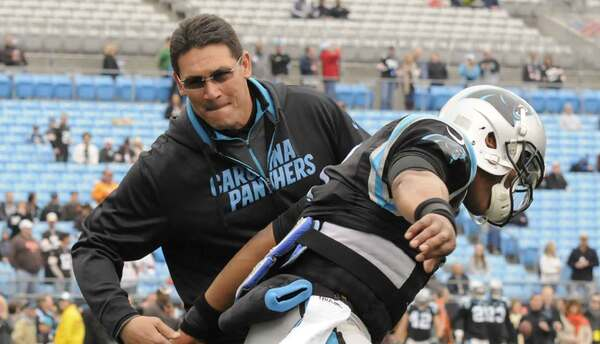 Ron Rivera y Cam Newton
