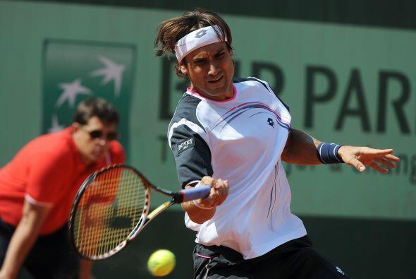 Ferrer no se inmutó y siguió con su trabajo para ganar el tercer set con...