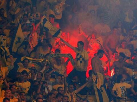 La afición del Maccabi celebra la victoria de su equipo frente al...