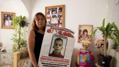 En la foto, Marisela Escobedo mostraba la imagen del asesino confeso de...