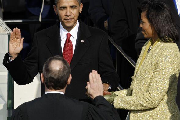 En una helada mañana de enero del año siguiente, Obama se convertía en e...