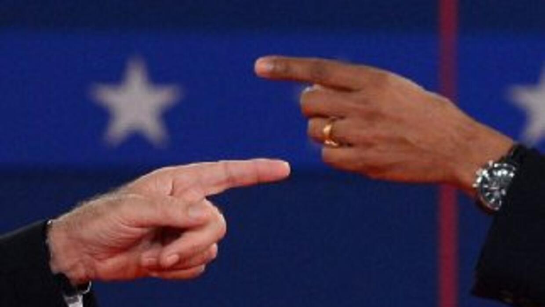 El candidato presidencial republicano Mitt Romney y el presidente Barack...