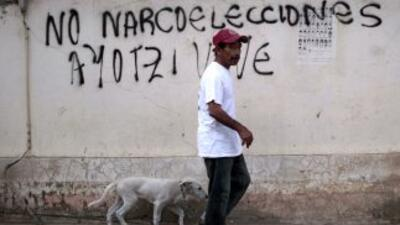 Una pinta en Guerrero, México, llamando al boicot de las elecciones.