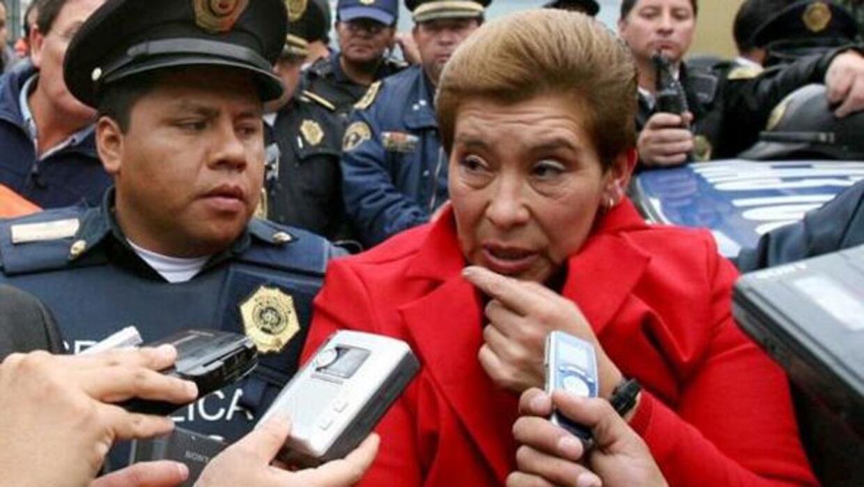 Fue así como fue capturada, de rojo como acostumbraba vestir para matar....