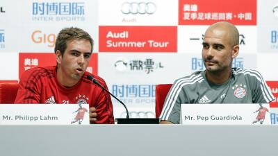 Philipp Lahm y Josep Guardiola