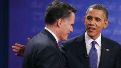 El Presidente Barack Obama y el candidato presidencial republicano, Mitt...