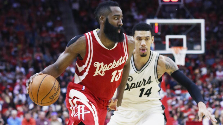 HOUSTON, TX - DECEMBER 25: James Harden #13 of the Houston Rockets drive...