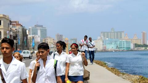 A group of miki high-school students walk along the Malecón in Ha...
