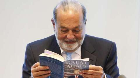 Mexican billionaire Carlos Slim reading from one of the works of Donald...
