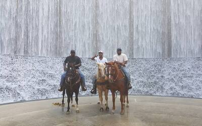 Woody Fields with buddies in front of the Water Wall in Houston, TX
