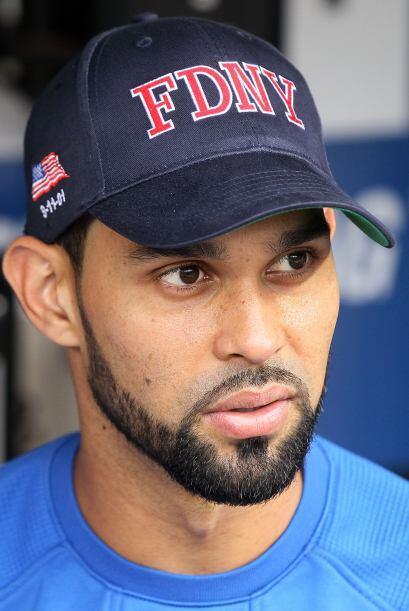 Al igual que los Yankees, los Mets usaron gorras del FDNY.