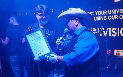 Sunny Sauceda accepts recognition from the Governor of Texas