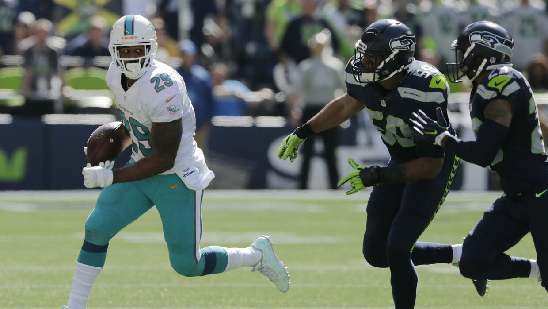 Arian Foster no pudo rendir a su llegada con los Dolphins.