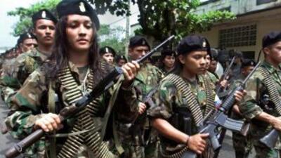 Aunque la mayoría de los integrantes de las FARC son hombres, en sus fii...