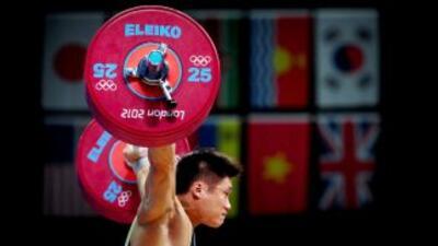 El chino Lu Xiaojun ganó, con dos nuevos récords mundiales, la medalla d...