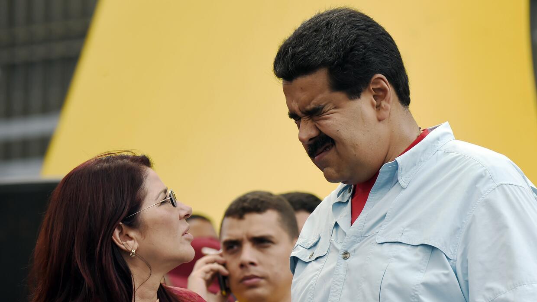 El presidente Nicolás Maduro junto a la primera dama de Venezuela...
