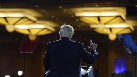 El presidente Trump habla ante la audiencia que asiste a la Conferencia...