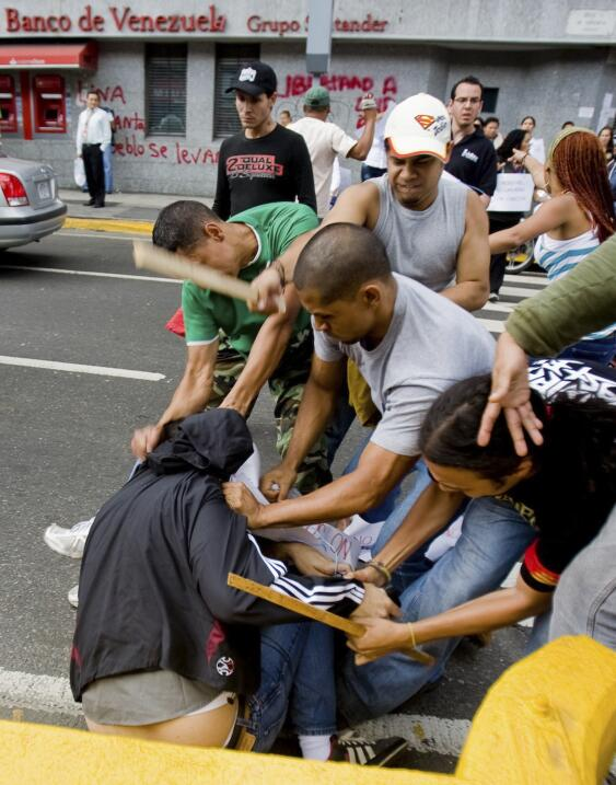 Journalists from newspaper Ultimas Noticias are attacked during a protes...