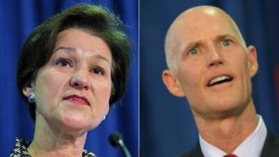 La demócrata Alex Sink y el republicano Rick Scott aspiran al puesto de...