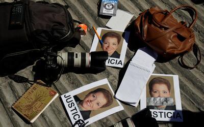 Cámaras y libretas de periodistas durante una protesta en Ciudad...