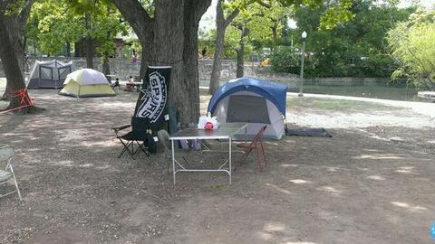 A family camping out at Brackenridge Park