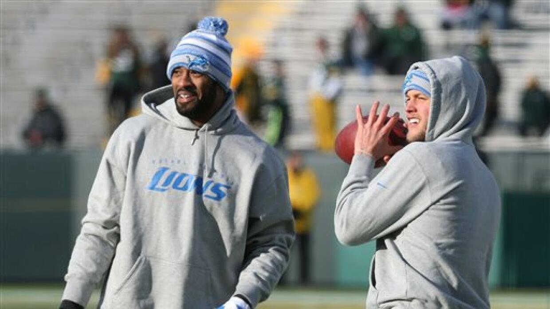 Calvin Johnson y Matthew Stafford en el 2014 previo a un partido (AP-NFL).