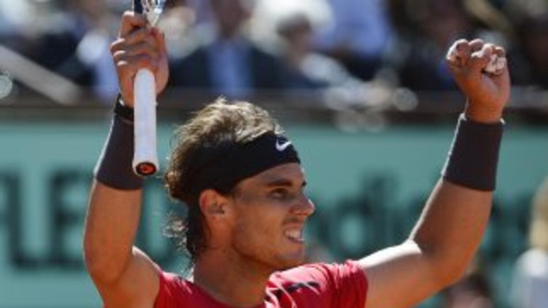 Rafael Nadal celebra su triunfo sobre su amigo David Ferrer.