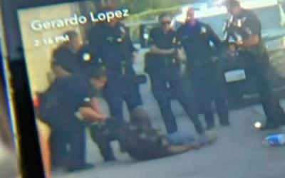 Momento del hombre arrestado captado por cámara de teléfon...