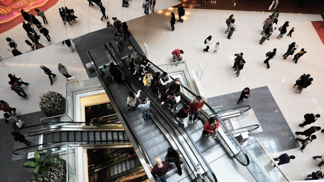 Shoppers wander around one biggest shopping mall in Hong Kong on January...