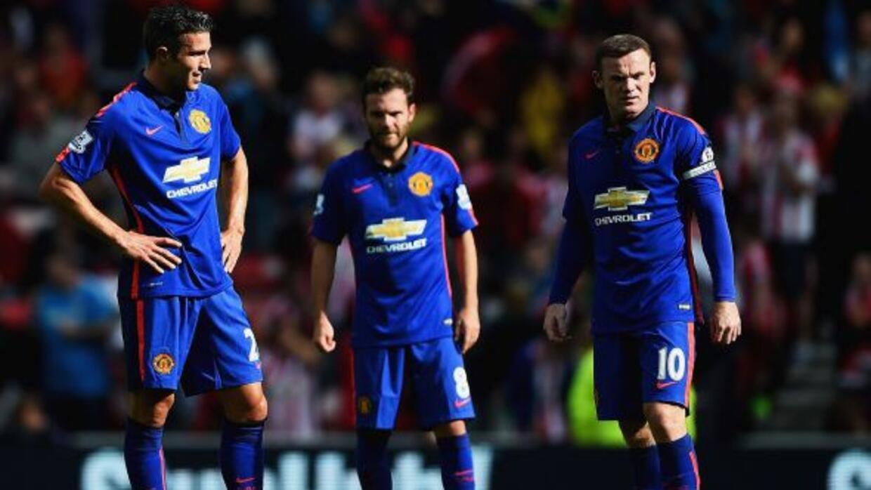 Van Persie, Mata (autor del gol) y Rooney, figuras de los 'Red Devils',...