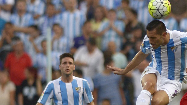 Charles (derecha) hizo los goles del Málaga.