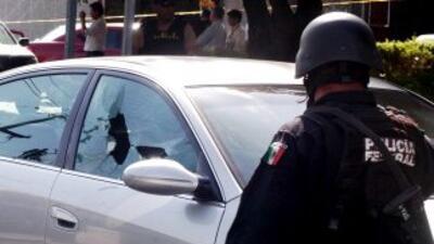 Enfrentamiento entre un grupo de hombres armados y elementos de la Polic...