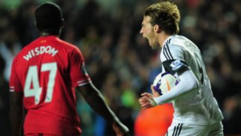 El español Michu marcó el tanto para el 2-2 definitivo, pero lso 'reds'...