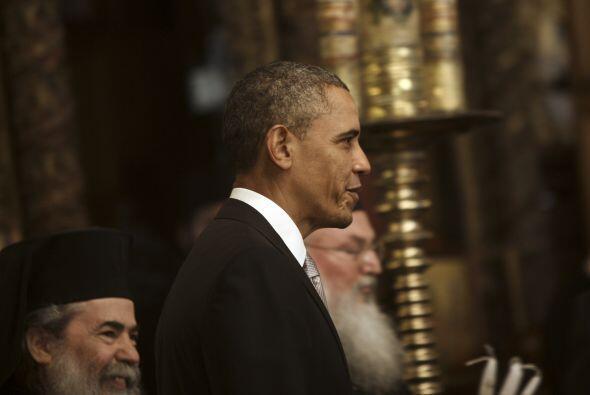 Obama, que iba acompañado por el secretario de Estado, John Kerry...