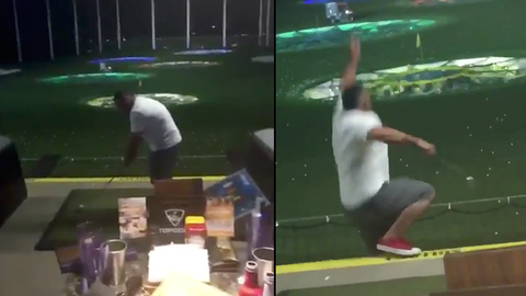 Man playing at a multi-level golf range falls off