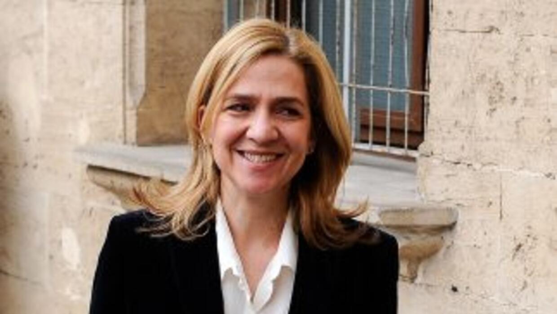 LaInfanta Cristina, sonriente a su llegada a la comparecencia.