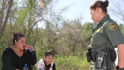 """""""Why are you crying?"""" agent Marlene Castro asks a Salvadoran w..."""