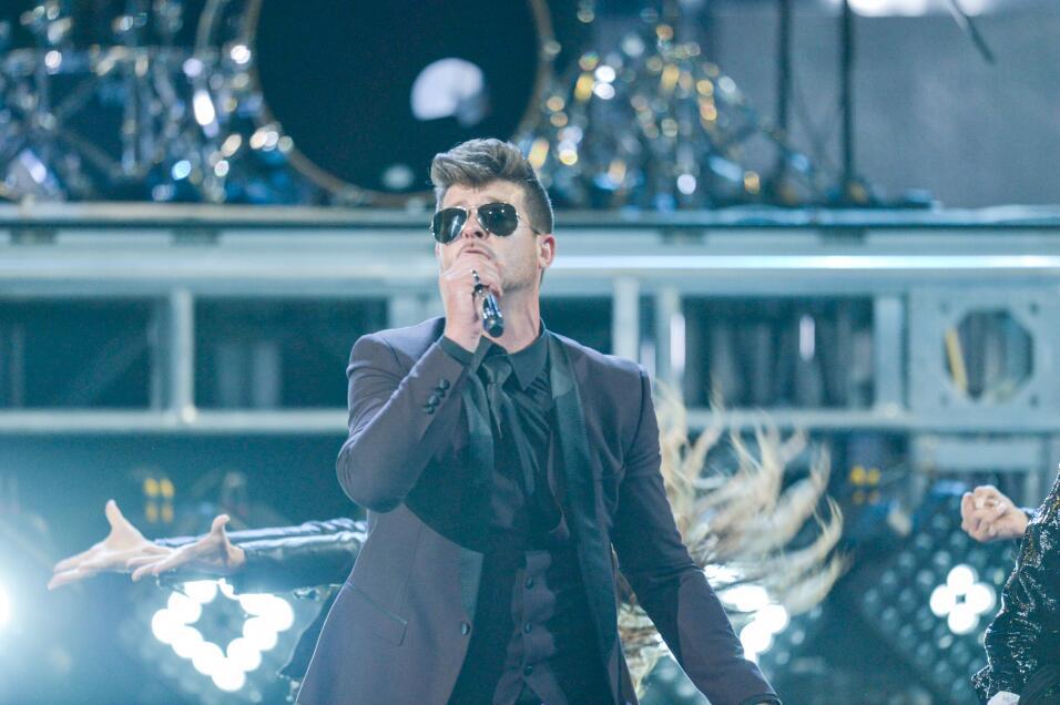 También el cantante Robin Thicke compartió con rapero cubanoamericano.