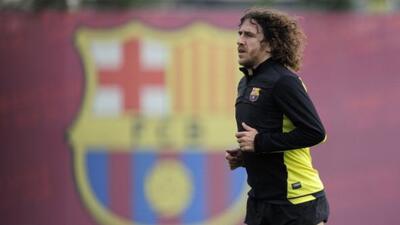 Carles Puyol no quiere que sus compañeros se rindan.