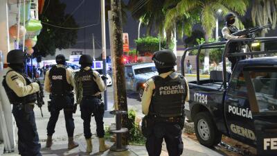 Agentes en la zona donde capturaron al presunto jefe de la delincuencia