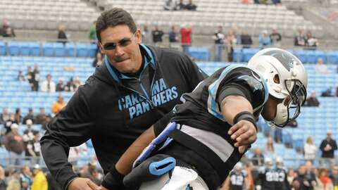 Ron Rivera y Cam Newton