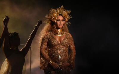 Beyonce performs as she is pregnant with twins during the 59th Annual Gr...