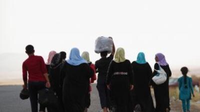 El avance de la insurgencia sunita en Irak desencadenó un nuevo éxodo de...