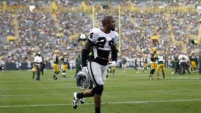Charles Woodson (AP-NFL).