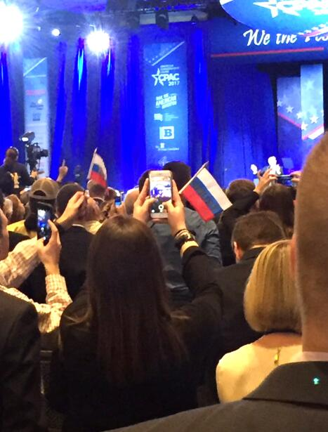 """A LMAO moment captured @ CPAC. Crowd waving """"Trump"""" flags that..."""