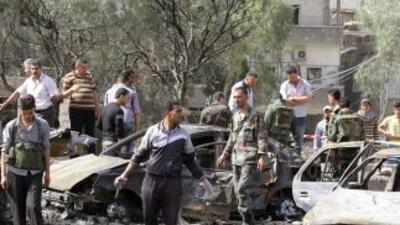 En el lugar de los atentados, los cuerpos destrozados se mezclaban con l...