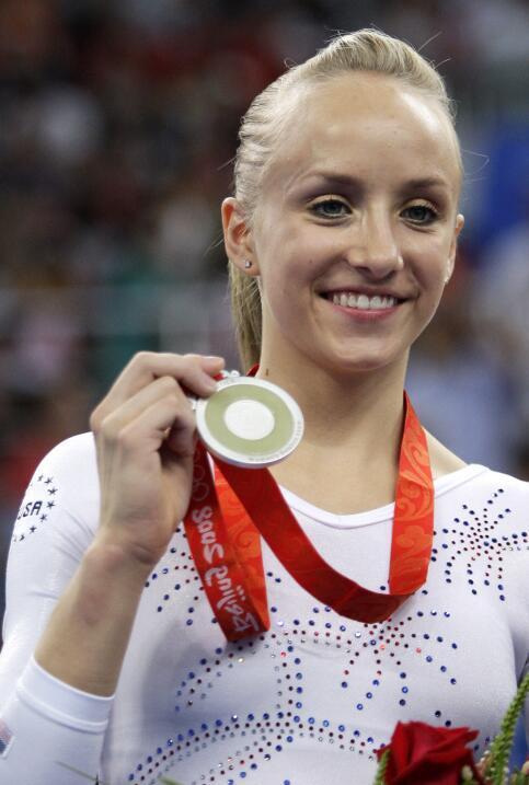 En el concurso completo de gimnasia, en Pekín, la estadounidense...
