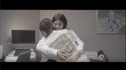 Kylie Jenner and rapper Travis Scott share a hug during a doctor's appoi...